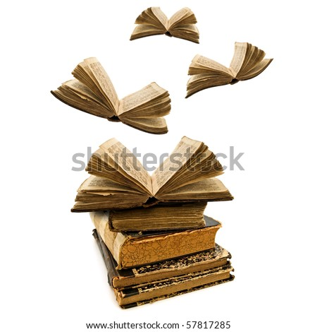 education concept: opened old books flying away
