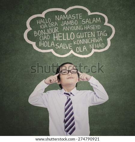 Education concept: schoolboy learn multi-languages at class