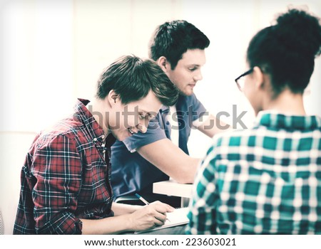education concept - student with notebook studying at school
