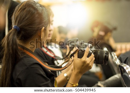 Education concept woman hand holding camera in workshop room