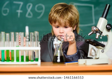 Education concept. Wunderkind experimenting with chemistry. Boy test tubes liquids chemistry. Chemical analysis. Talented scientist. Kid study chemistry. Biotechnology and pharmacy. Genius pupil.