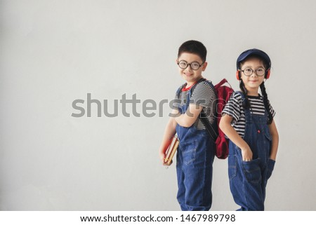 Education concepts - The little boy and little girl were smiling with backpacks and back to school. The first semester of the children.