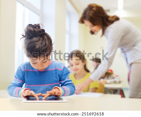 education, elementary school, technology and children concept - little student girl with tablet pc over classroom and teacher background - stock photo