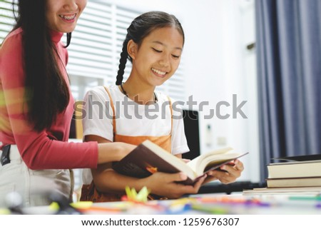 Education family doing homework young and grand sister lesson practice preparing exam, Asian girls.
