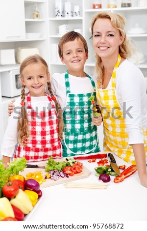 Education for a healthy diet - kids with their mother in the kitchen
