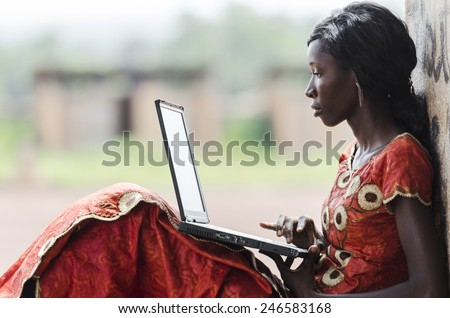 Education for Africa: Technology Symbol African Woman Studying Learning Lesson #246583168