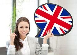 education, foreign language, english, people and communication concept - smiling woman holding text bubble of british flag and pointing finger up