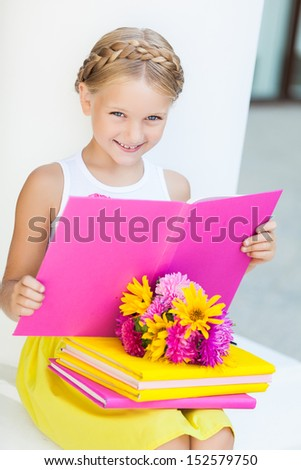 Education - funny girl with a books and flowers