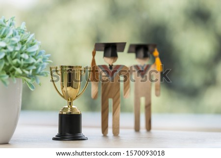 Education graduation in achievement success concept: Students university models with golden trophy winner cup, intelligence for management study competition leadership and inspiration in life