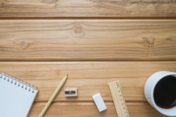 Education image of start working set such as hot coffee , pencil and notebook on vintage wooden table , top view background