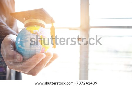 Education in Global, Graduation cap on Businessman holding Earth globe model map with Radar background in hands. Concept of global business, abroad international educational, Back to School. #737241439