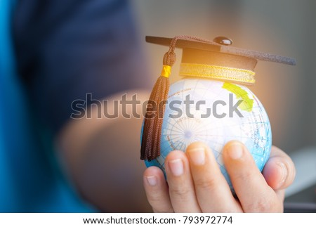 Education in Global, Graduation cap on Businessman holding Earth globe model map with Radar background in hands. Concept of global business, abroad educational, Back to School. #793972774