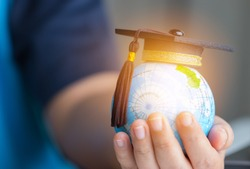 Education in Global world, Graduation cap on Businessman holding Earth globe model map with Radar background in hands. Concept of global business study, abroad educational, Back to School.