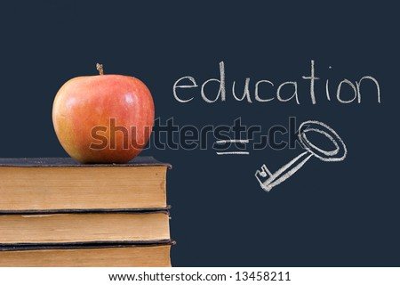 education = key is written on blackboard with apple, books