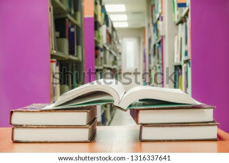 Education learning concept with opening book or textbook in old library and background bookshelf for education. #1316337641