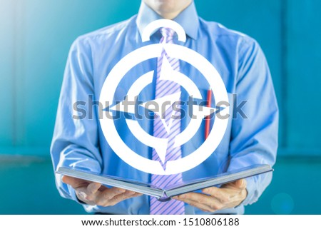 Education Navigator. Man or student hold book with compass icon. #1510806188