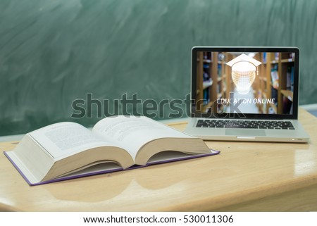 education online concept,laptop computer and book in classroom stock photo