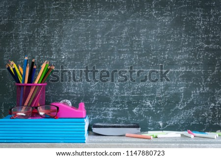 Education or back to school Concept. glasses, pencils, note books, chalk, eraser over chalkboard background. #1147880723