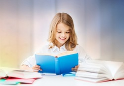 education, people, children and school concept - happy smiling student girl reading book over rose quartz and serenity gradient background