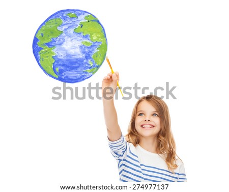 education, school and imaginary screen concept - cute little girl drawing with brush planet earth