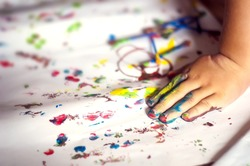 education, school, art and painting concept - little student girl showing painted hands
