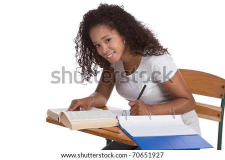 education series - ethnic black woman high school student sitting by school desk doing homework