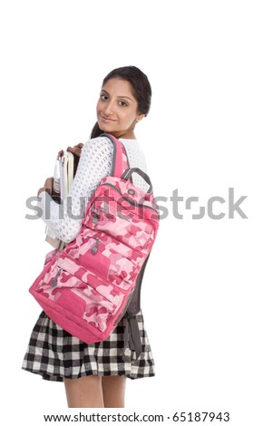 education series - Friendly ethnic Indian female high school student with backpack and composition book