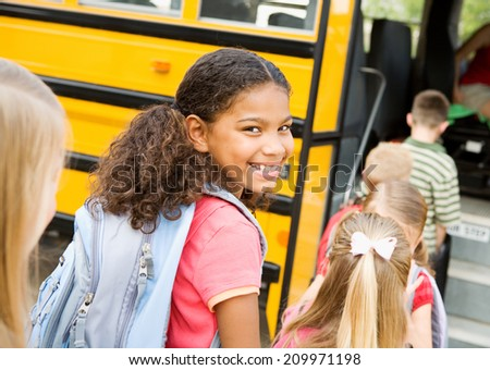 Education: Smiling Elementary Student Ready To Board Bus