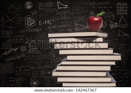 Education symbol of apple and stack of books in class