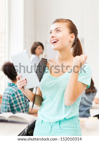 education, technology and internet concept - happy student girl with tablet pc