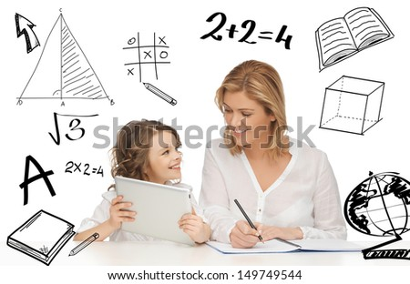 education technology internet and parenting concept girl and mother doing homework with tablet pc