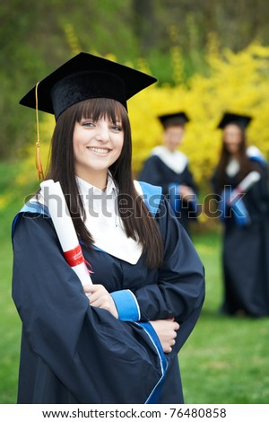 education theme of happy graduate student girl outdoors