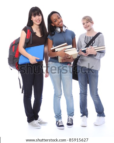 Education time for three multi ethnic teenage student girl friends made up of mixed race african american, oriental Japanese and caucasian with school books.