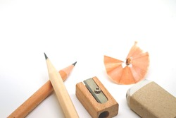 Education tool ,Pencil, Scrap Eraser and Sharpener made of wood on white background with copy space