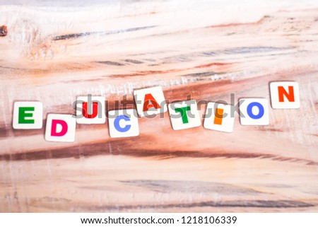 EDUCATION WRITTEN ON WOODEN TABLE WITH BLOCK LETTERS INDICATES SCHOOL EDUCATION PRIMARY EDUCATION  #1218106339