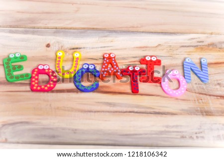 EDUCATION WRITTEN ON WOODEN TABLE WITH BLOCK LETTERS INDICATES SCHOOL EDUCATION PRIMARY EDUCATION  #1218106342