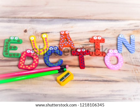 EDUCATION WRITTEN ON WOODEN TABLE WITH BLOCK LETTERS INDICATES SCHOOL EDUCATION PRIMARY EDUCATION  #1218106345