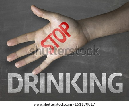 Educational and Creative composition with the message Stop Drinking on the blackboard