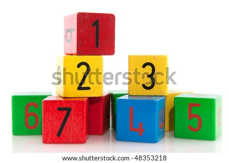 Educational colorful blocks with different numbers over white