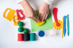 Educational game with clay. Child sculpting figures from clay.