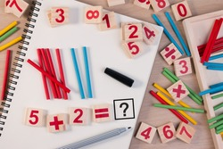 Educational kids math toy wooden board stick game counting set in kids math class kindergarten. Math toy kids concept.