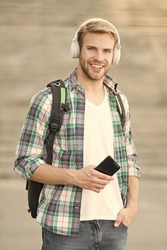 Educational technology use physical hardware software and educational theoretic. College education. College life. College student headphones smartphone. Listen music. Audio book. Modern and digital.