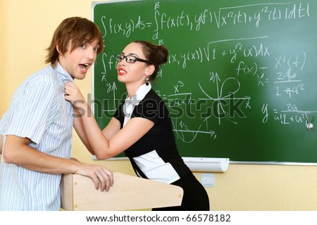 Educational theme: angry teacher with her student at a classroom. #66578182
