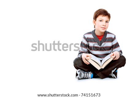 Educational theme: portrait of a schoolboy with books. Isolated over white background.