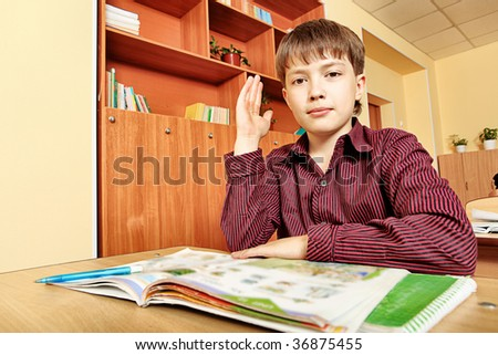 Educational theme: schoolboy in a classroom.