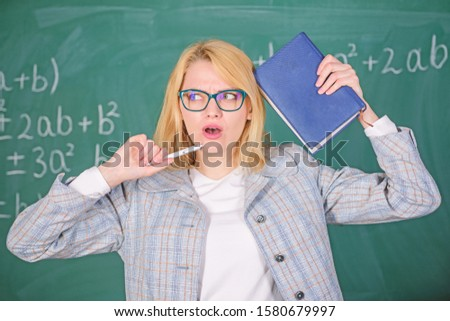 Educator woman hold book and pen chalkboard background. Looking for inspiration. Inspired work harder or pursue particular goal. Learn be inspiring teacher. Inspiring educator spark motivation.