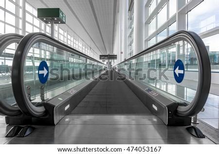 Eelctric speedwalk on an airport #474053167