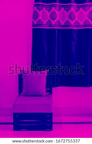 Eerie look of a furniture piece in pink blue duotone effect.  Stock fotó ©