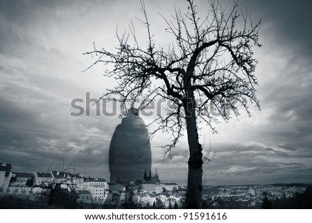 Eerie person and dramatic sky over Prague, Czech Republic