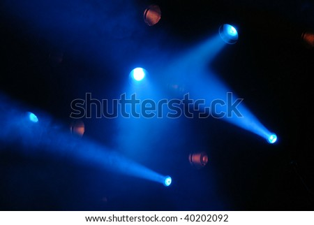 effect of a smoke and illumination on a scene during a musical concert #40202092